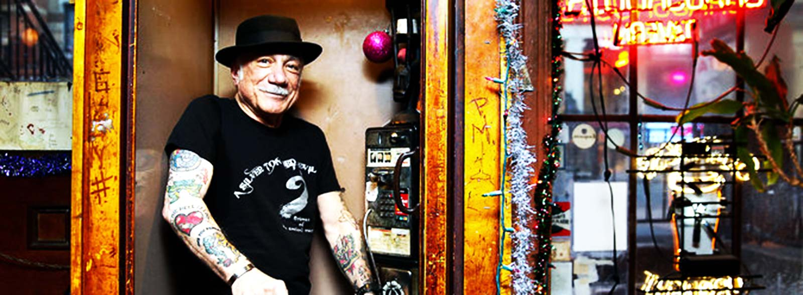 The poet Phillip Giambri at Grassroots Tavern on St. Marks Place, one of his frequent haunts. Credit Nicole Craine for The New York Times